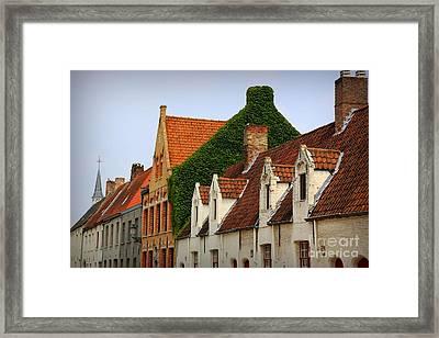 Bruges Rooftops Framed Print by Carol Groenen