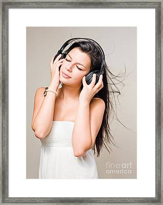 Brunette Immersed In Music Wearing Headphones. Framed Print by Alstair Thane