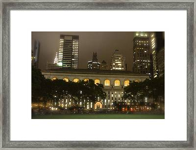 Bryant Park In New York City At Night Framed Print by Michael Dagostino