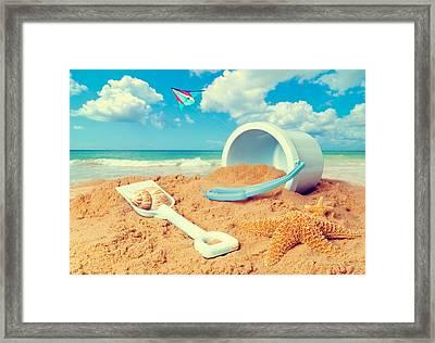 Bucket And Spade On Beach Framed Print by Amanda Elwell