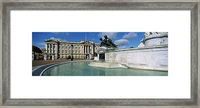 Buckingham Palace And The Queen Framed Print by Panoramic Images