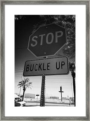 buckle up sign below stop sign in Las Vegas Nevada USA Framed Print by Joe Fox