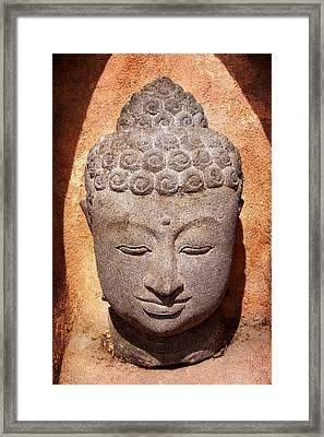 Buddha In Light And Shadow Framed Print