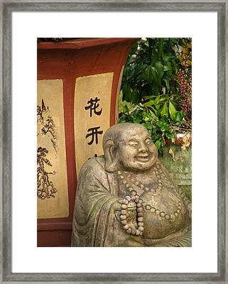 Buddha Statue In The Garden Framed Print