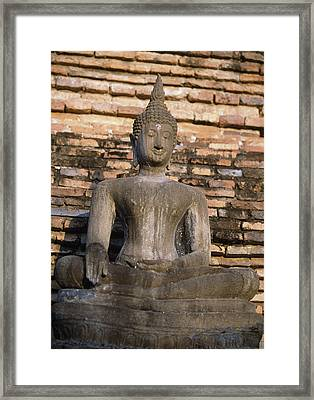 Buddha Statue Outside Thai Temple Framed Print by Richard Berry
