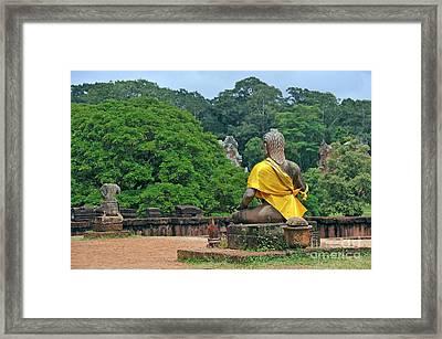 Buddha Statue Wearing A Yellow Sash Framed Print by Sami Sarkis