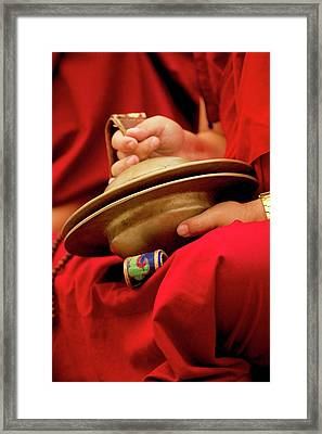 Buddhist Lama Monk With Large Cymbals Framed Print by Jaina Mishra