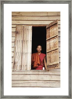 Buddhist Monk In Window Framed Print by Andy Kerry