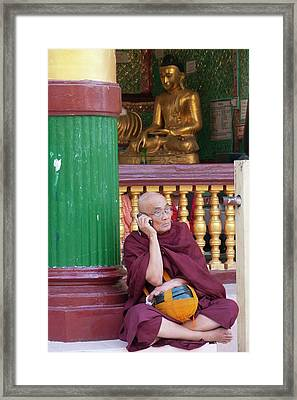 Buddhist Monk On Mobile Phone Framed Print by Peter Menzel
