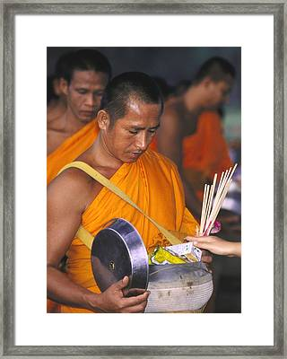 Buddhist Monks Receiving Alms Framed Print by Richard Berry