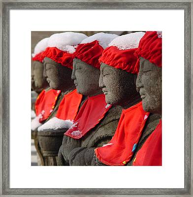 Framed Print featuring the photograph Buddhist Statues In Snow by Larry Knipfing