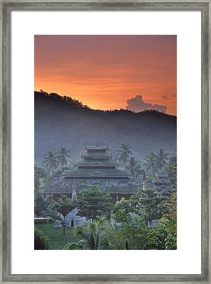 Buddhist Temple At Sunset Framed Print by Richard Berry