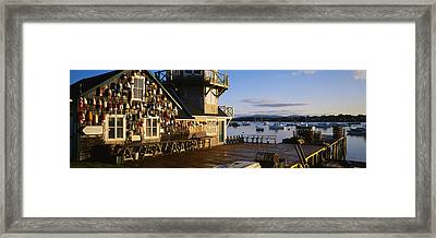 Building At The Waterfront, Fishing Framed Print by Panoramic Images