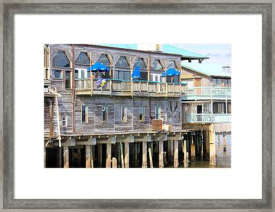 Building On Piles Above Water Framed Print by Lorna Maza