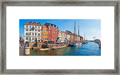 Buildings Along A Canal With Boats Framed Print