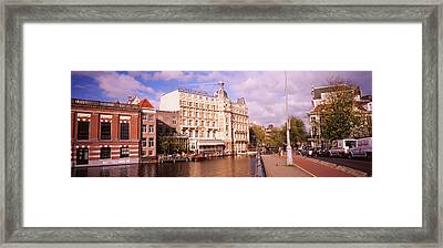 Buildings Along A Water Channel Framed Print by Panoramic Images