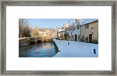 Buildings Along Snow Covered Street Framed Print by Panoramic Images