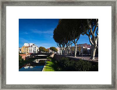 Buildings Along The Basse Riverfront Framed Print