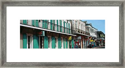 Buildings Along The Bourbon Street Framed Print by Panoramic Images