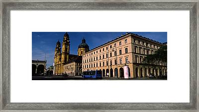 Buildings At A Town Square Framed Print