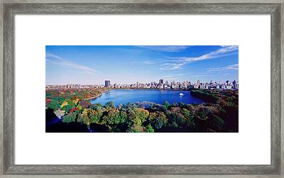 Buildings In A City, Central Park Framed Print