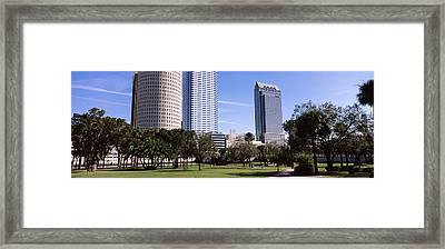 Buildings In A City Viewed From A Park Framed Print by Panoramic Images
