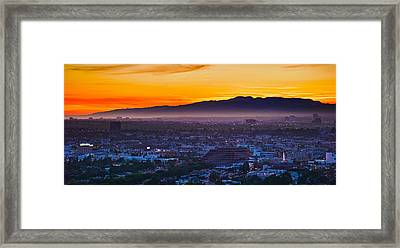 Buildings In A City With Mountain Range Framed Print
