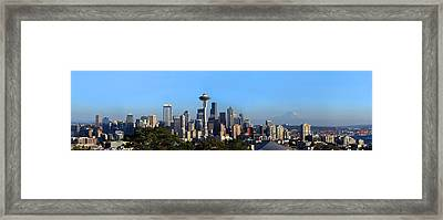 Buildings In A City With Mountains Framed Print