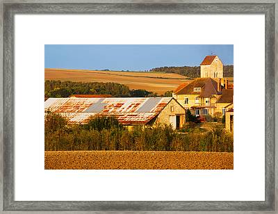 Buildings In A Town At Morning Framed Print by Panoramic Images