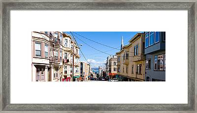 Buildings In City With Bay Bridge Framed Print by Panoramic Images