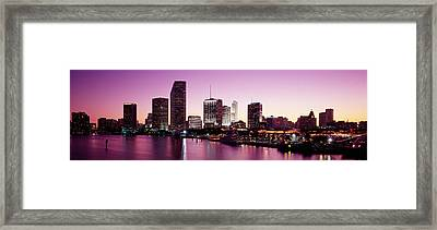 Buildings Lit Up At Dusk, Biscayne Bay Framed Print by Panoramic Images
