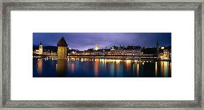 Buildings Lit Up At Dusk, Chapel Framed Print by Panoramic Images
