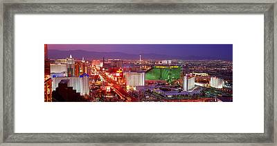 Buildings Lit Up At Dusk In A City, Las Framed Print