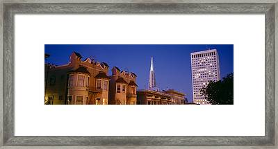 Buildings Lit Up At Dusk, Transamerica Framed Print by Panoramic Images