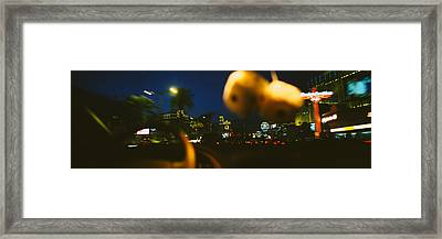 Buildings Lit Up At Night Viewed Framed Print