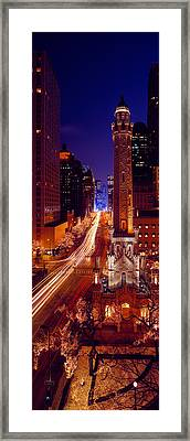 Buildings Lit Up At Night, Water Tower Framed Print by Panoramic Images