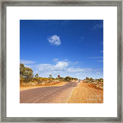 Bumpy Desert Road Outback Queensland Australia Framed Print by Colin and Linda McKie