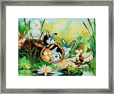 Bunnies Log And Frog Framed Print by Hanne Lore Koehler