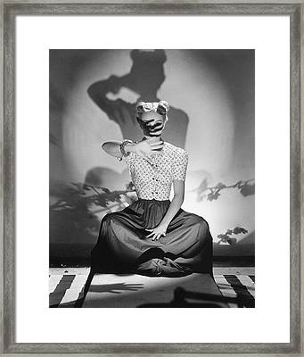 Bunny Hartley Casting A Shadow On Her Face Framed Print