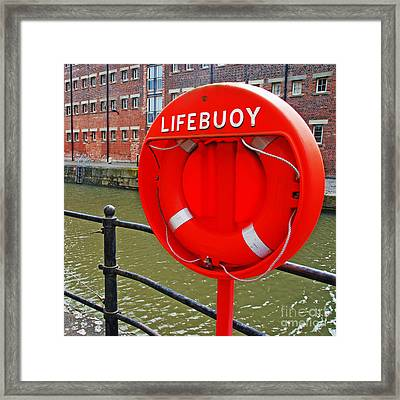 Buoy Foam Lifesaving Ring Framed Print by Luis Alvarenga