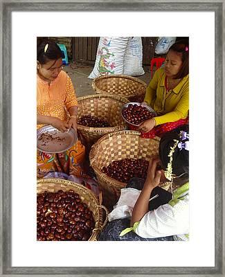 Framed Print featuring the photograph Burmese Ladies Sorting Water Chestnuts Zay Cho Street Market 29th Street Mandalay Burma by Ralph A  Ledergerber-Photography