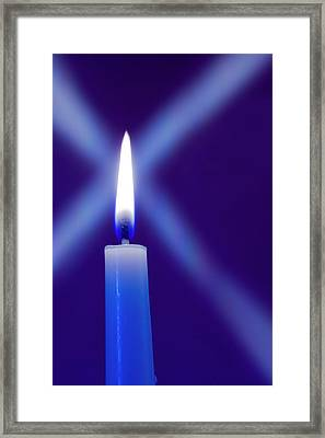 Burning Candle With Star Burst On Blue Framed Print by Jaynes Gallery