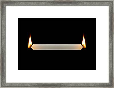 Burning The Candle At Both Ends Framed Print