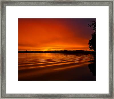 Burning Waves Framed Print by Dan Holland