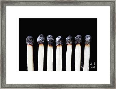 Burnt Matches On Black Framed Print