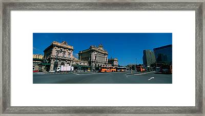 Bus Parked In Front Of A Railroad Framed Print by Panoramic Images