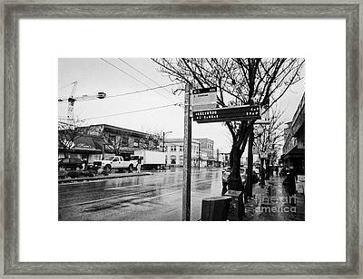 bus stop on main street heading downtown from mount pleasant on a wet day Vancouver BC Canada Framed Print