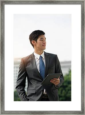 Businessman Holding Digital Tablet Framed Print by Eternity In An Instant