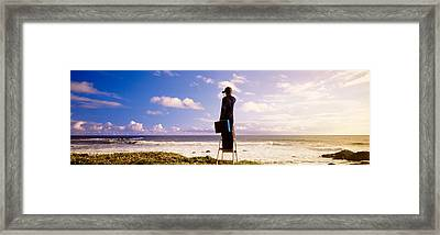 Businessman Standing On A Ladder And Framed Print