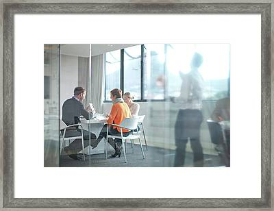 Businesspeople Having Meeting At Framed Print by Zero Creatives